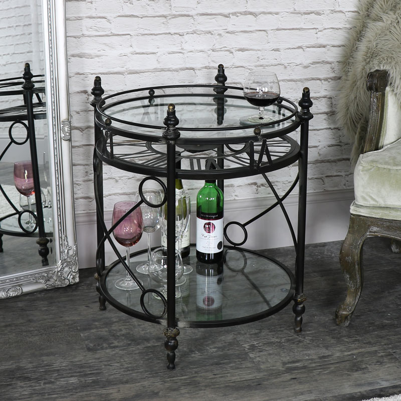 Round Ornate Black Skeleton Clock Table with Shelf